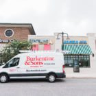 Burkentine & Sons van in front of shopping complex