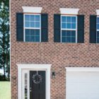 brick house with attached garage